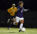 SIOUX FALLS, SD - NOVEMBER 1:  Maria Gonzalez #9 from the University of Sioux Falls passes the ball against Augustana in the first half of their game Friday night at the USF Sports Complex. (Photo by Dave Eggen/Inertia)