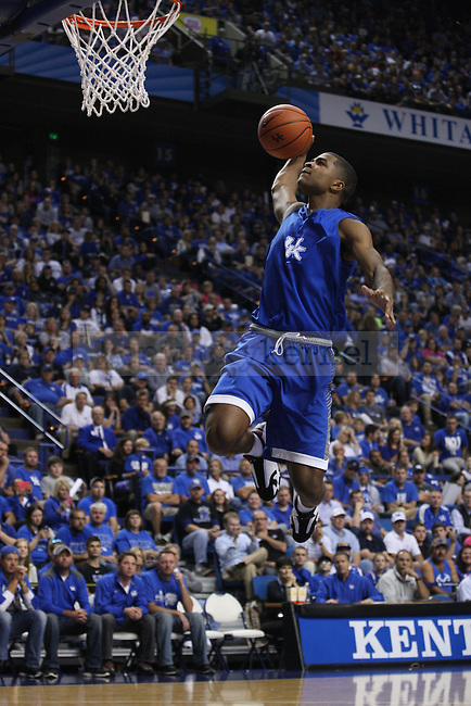 Guard Andrew Harrison jumps for a dunk during the second half of the Blue-White Scrimmage at Rupp Arena on Monday, October 27, 2014 in Lexington, Ky. Photo by Adam Pennavaria | Staff