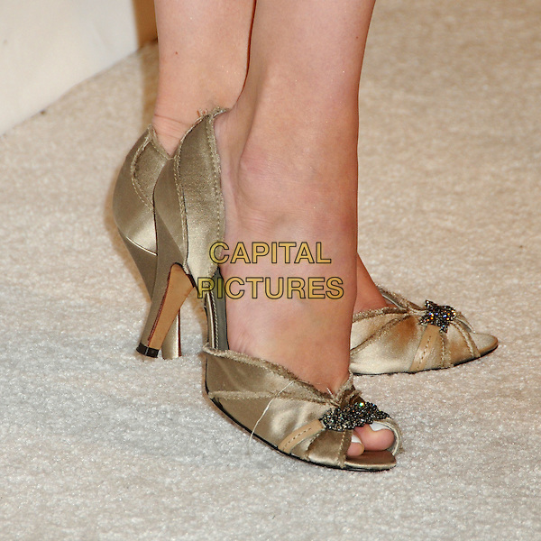 MELORA HARDIN's shoes .3rd Annual Women In Film Pre-Oscar Party held at a Private Residence in Beverly Hills, California, USA, .4th March 2010..detail gold open peep toe frayed edge silk satin cream feet .CAP/ADM/BP.©Byron Purvis/AdMedia/Capital Pictures.