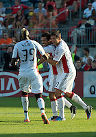 23 June 2011: New England Revolution midfielder Benny Feilhaber #22 celebrates his equalizing goal with New England Revolution forward Saer Sene #39 and New England Revolution forward Blake Brettschneider #23 during an MLS game between the New England Revolution and the Toronto FC at BMO Field in Toronto..The game ended in a 2-2 draw.
