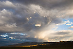 Rainbow, clouds, dissipating summer storm over the Garfield Hills of central Nevada