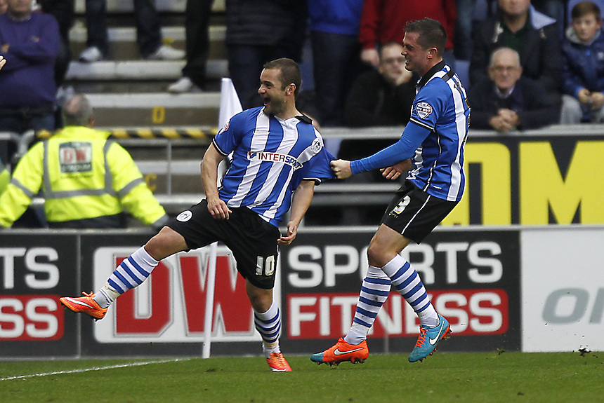Wigan Athletic's Shaun Maloney celebrates scoring his sides first goal  with  Andrew Taylor<br /> <br /> Photographer Mick Walker/CameraSport<br /> <br /> Football - The Football League Sky Bet Championship - Wigan Athletic v Middlesbrough - Saturday 22nd November 2014 - DW Stadium - Wigan<br /> <br /> &copy; CameraSport - 43 Linden Ave. Countesthorpe. Leicester. England. LE8 5PG - Tel: +44 (0) 116 277 4147 - admin@camerasport.com - www.camerasport.com