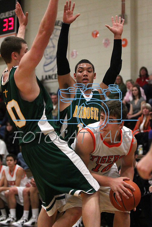 Douglas' Trevor Shaffer looks to pass during a boys basketball game between Bishop Manogue and Douglas High in Minden, Nev., on Thursday, Dec. 22, 2011..Photo by Cathleen Allison