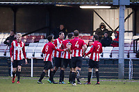 AFC Hornchurch players celebrate with double goal scorer George Purcell during AFC Hornchurch vs Haringey Borough, Bostik League Division 1 North Football at Hornchurch Stadium on 10th February 2018