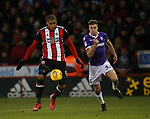 Leon Clarke of Sheffield Utd and Reece Burke of Bolton Wanderers during the Championship match at Bramall Lane Stadium, Sheffield. Picture date 30th December 2017. Picture credit should read: Simon Bellis/Sportimage