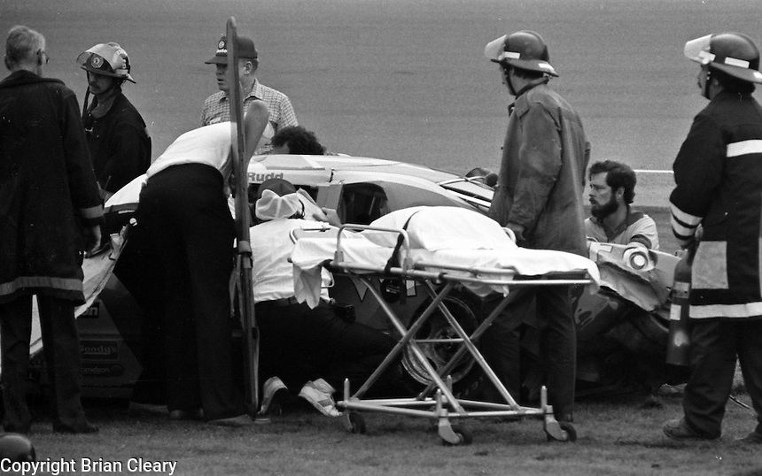 rescue crew tends to Ricky Rudd after crash accident in Busch Clash  at Daytona International Speedway in Daytona Beach, FL on February  1984. (Photo by Brian Cleary/www.bcpix.com)