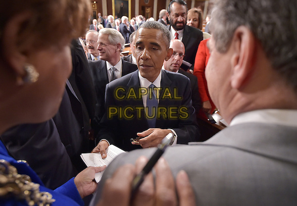 US President Barack Obama signs autographs after delivering the State of the Union address before a joint session of Congress on January 20, 2015 at the US Capitol in Washington, DC.  <br /> CAP/MPI/MAN<br /> &copy;MAN/MPI/Capital Pictures