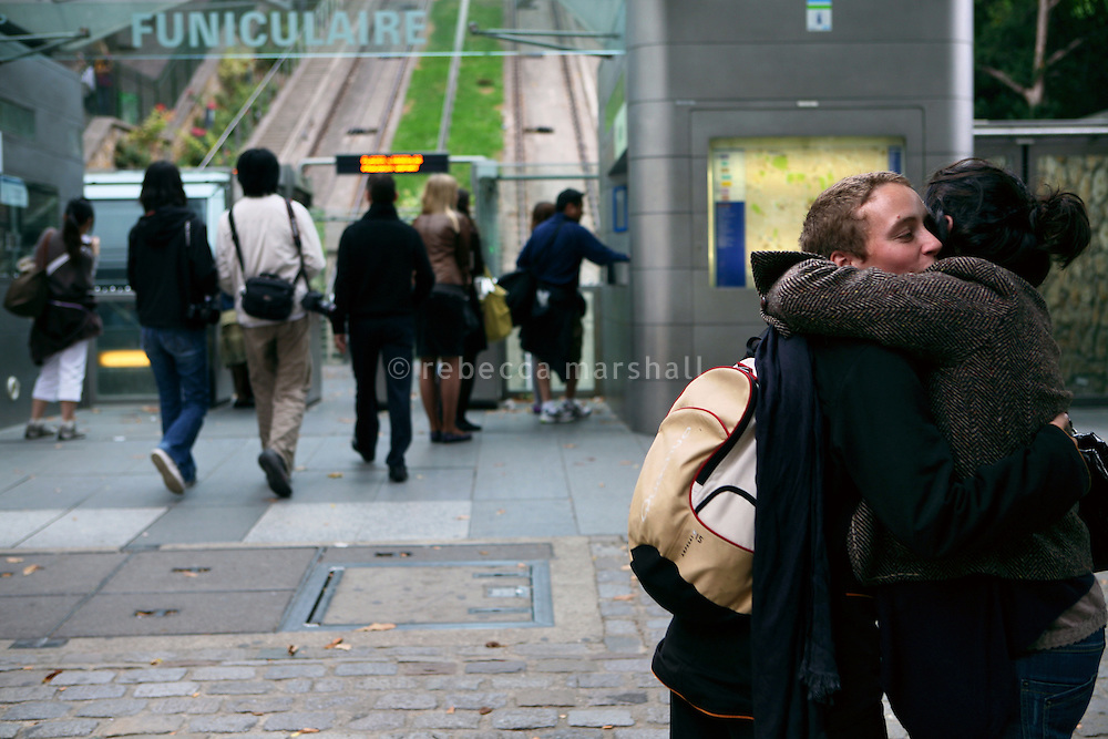 Friends greet each other at the entrance to the Montmartre Funicular, Place Willette, Paris, France, 16 September 2009