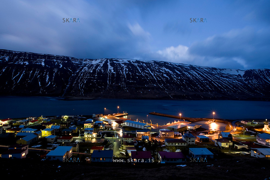 It's 5 pm and most workers are heading home as the twilight covers Suðureyri. The Sun does not come out for six months a year. Due south of Suðureyri, mount Spillir (Spoiler), earns its rugged name by blocking out the noon sun from October to march. Every march, the people of the Western fjords celebrate the emergence of the sun from behind the steep mountains that hide it from view. Winter depression is a common ailment in the Western fjords, but Anna and Jarek say they have adjusted quite well to the darkness. No doubt the growing community of polish immigrant fosters resilience and optimism, while the indigenous Icelandic people watch generations leave their homes.