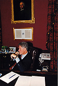 United States President Bill Clinton phones President Boris Yeltsin of Russia from his study in the White House residence on September 21, 1993.<br /> Credit:  White House via CNP