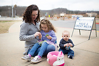 """NWA Democrat-Gazette/CHARLIE KAIJO Amber Eddings of Bella Vista (from left) opens Easter eggs with Piper Eddings, 3 and Parker Eddings, 9 months, Sunday, March 25, 2018 at Cooper Elementary in Bella Vista. <br /><br />Northwest Community Church hosted a Palm Sunday egg hunt at Cooper Elementary where they also hold Sunday worship.<br /><br />""""We are using this as an opportunity to reach out and serve the community,"""" said <br />Family and Missions Pastor Scott Sanders. """"A lot of people are doing Easter egg hunts next week and we wanted to do something a little different.""""<br /><br />""""We're not a church with an actual building. We want people to know we exist. We have that as a purpose and we also just want to serve the community,"""" he added."""