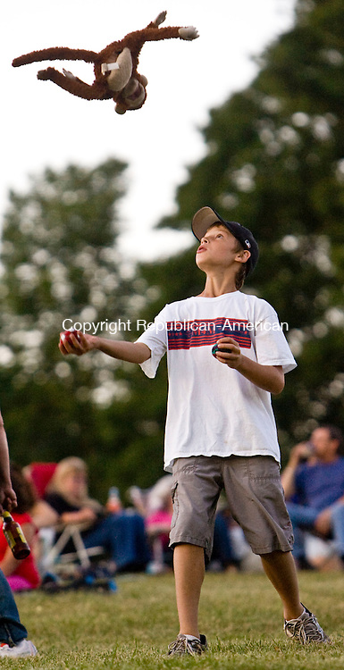 SALISBURY. CT - 03 JULY 2010 -070310JT03-<br /> Ben Green, 11, of Farmington, juggles a ball, an apple and a toy monkey  at Lime Rock Park in Salisbury before the Independence Day fireworks display on Saturday.<br /> Josalee Thrift Republican-American