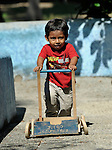 Three-year old son Eduardo de Jesus Ruiz plays with a cart during a session of the early intervention program of Piña Palmera, a center for community based rehabilitation for people living with disabilities in Zipolite, a town in Oaxaca, Mexico. The boy lives with some developmental disability.