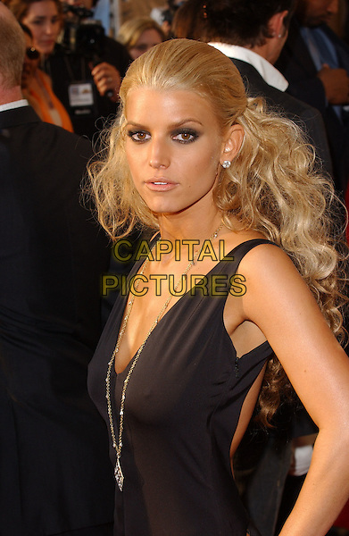 JESSICA SIMPSON.Attends The 2005 MTV Movie Awards held at The Shrine Theatre in Los Angeles, California, USA, .June 4th 2005..half length big hair extensions curly black dress necklace beads.Ref: DVS.www.capitalpictures.com.sales@capitalpictures.com.©Debbie VanStory/Capital Pictures