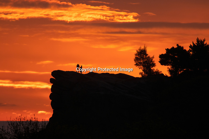 23/05/17<br /> <br /> Holding her Dachshund in her arms, Sharon Repton and her 79-year-old mother, Doreen Temperton, climb to the top of Black Rocks to watch the dawn break over Cromford in the Derbyshire Peak District.<br /> <br /> Black Rocks is a small outcrop of natural gritstone, between Cromford and Wirksworth. The area has been a well-known rock climbing venue since the 1890s. A large number of hard lines were put up by some of the best climbers of the 1980s and 1990s. <br /> <br /> All Rights Reserved, F Stop Press Ltd +44 (0)7765 242650 www.fstoppress.com rod@fstoppress.com