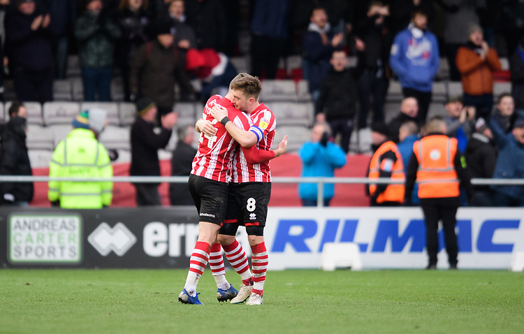 Lincoln City's Harry Toffolo, left, and Lincoln City's Lee Frecklington celebrate at the end of the game<br /> <br /> Photographer Chris Vaughan/CameraSport<br /> <br /> The EFL Sky Bet League Two - Lincoln City v Grimsby Town - Saturday 19 January 2019 - Sincil Bank - Lincoln<br /> <br /> World Copyright &copy; 2019 CameraSport. All rights reserved. 43 Linden Ave. Countesthorpe. Leicester. England. LE8 5PG - Tel: +44 (0) 116 277 4147 - admin@camerasport.com - www.camerasport.com