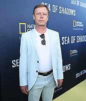 HOLLYWOOD, CALIFORNIA - JULY 10: Producer Wolfgang Knopfler attends the National Geographic Documentary Films' premiere of 'Sea Of Shadows' at NeueHouse Los Angeles on July 10, 2019 in Hollywood, California. (Photo by Frank Micelotta/National Geographic/PictureGroup)