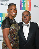 Ursula M. Burns, Chairman and Chief Executive Officer, Xerox, and Lloyd Bean arrive for the formal Artist's Dinner honoring the recipients of the 2014 Kennedy Center Honors hosted by United States Secretary of State John F. Kerry at the U.S. Department of State in Washington, D.C. on Saturday, December 6, 2014. The 2014 honorees are: singer Al Green, actor and filmmaker Tom Hanks, ballerina Patricia McBride, singer-songwriter Sting, and comedienne Lily Tomlin.<br /> Credit: Ron Sachs / Pool via CNP