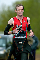 09 MAY 2010 - GRENDON, GBR - Duncan Hough runs to transition after exiting the swim at the Grendon Triathlon .(PHOTO (C) NIGEL FARROW)