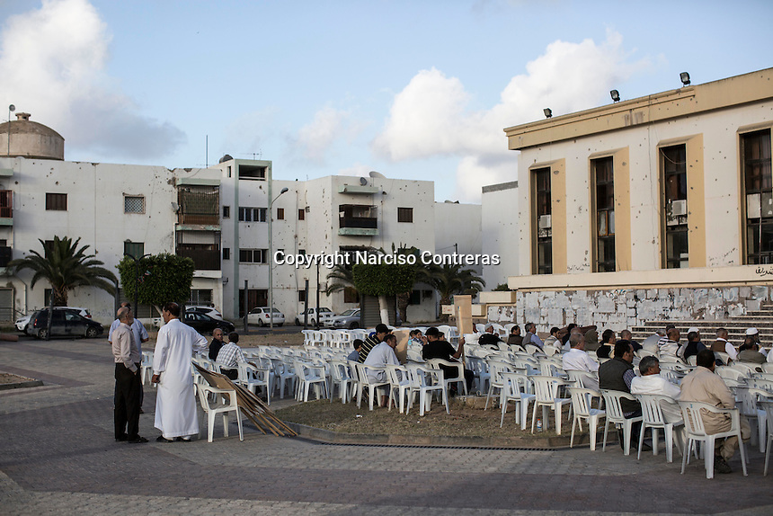 """Saturday 21, May 2016: Locals gather at the """"martyr's hall"""" in downtown Misrata to show their support to the forces fighting ISIL in Abugrein, Libya."""