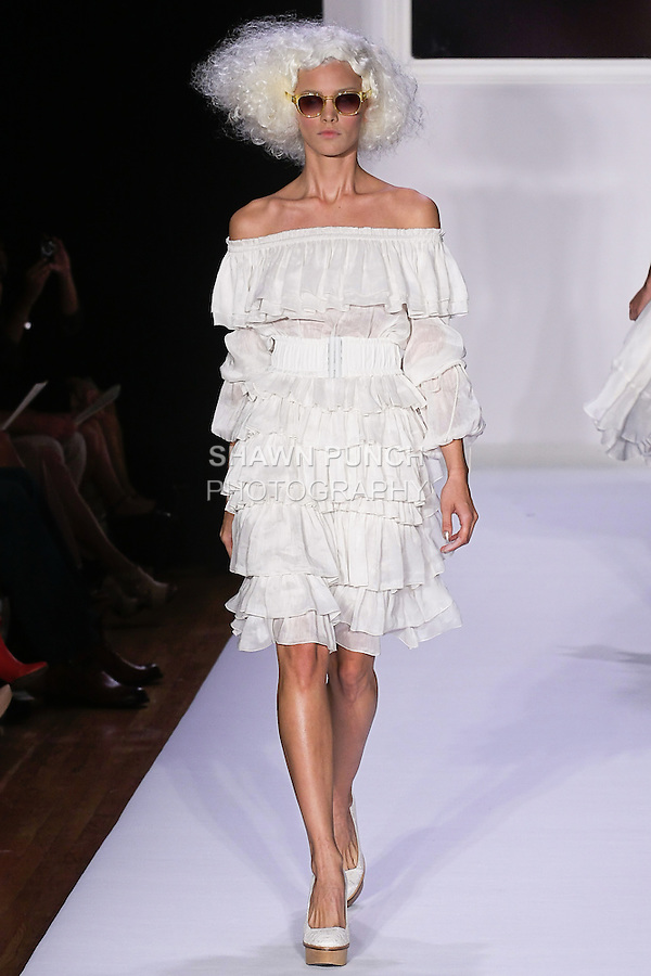 Tara walks runway in an alabaster ruffled bolero Eva dress, Natural canvas and antique lace tote.Adele natural lace and leather platform pump, for the bebe BLACK Spring 2012 collection fashon show, during Elle Stlye 360 Spring 2012 Fashion Week.