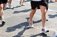 17 APR 2011 - LONDON, GBR - Runners pound the streets of London during the London Marathon (PHOTO (C) NIGEL FARROW)