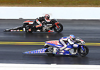 Mar 16, 2014; Gainesville, FL, USA; NHRA pro stock motorcycle rider Hector Arana Jr (near) races alongside Eddie Krawiec during the Gatornationals at Gainesville Raceway Mandatory Credit: Mark J. Rebilas-USA TODAY Sports