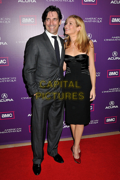 JON HAMM & JENNIFER WESTFELDT.23rd Annual American Cinematheque Awards at the Beverly Hilton Hotel, Beverly Hills, California, USA..December 1st, 2008.full length grey gray suit black dress couple hand in pocket john ham.CAP/ADM/BP.©Byron Purvis/AdMedia/Capital Pictures.