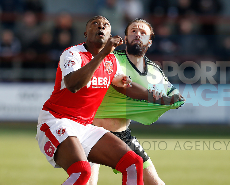 Shola Ameobi of Fleetwood Town  tussles with John Brayford of Sheffield Utd - English League One - Fleetwood Town vs Sheffield Utd - Highbury Stadium - Fleetwood - England - 5rd March 2016 - Picture Simon Bellis/Sportimage