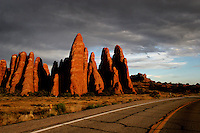 Red rocks next to the road, in Arches National Park, Utah, USA. August 5, 2005.Born in Argentina, photographer Ivan Pisarenko in 2005  decided to ride his motorcycle across the American continent. While traveling Ivan is gathering an exceptional photographic document on the more diverse corners of the region. Archivolatino will publish several stories by this talented young photographer..
