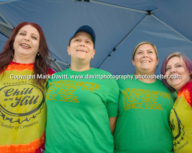 Pleasant Hill held its first of the summer Chill on the Hill June 23 at Copper Creek Lake. Amy Gruver, Nicci Baker, Wendy Martinez and Donna Reyes show office last year's and this year's tee-shirts, green.