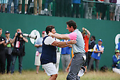 20.07.2014. Hoylake, England. Rory McIlroy of Northern Ireland, right, celebrates his winning with his mother on the 18th hole during the final round of the 143rd British Open Championship at Royal Liverpool Golf Club in Hoylake, England.