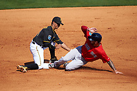 Pittsburgh Pirates shortstop Cole Figueroa (24) attempts to tag Blake Swihart (23) sliding safely into second base during a Spring Training game against the Boston Red Sox on March 9, 2016 at McKechnie Field in Bradenton, Florida.  Boston defeated Pittsburgh 6-2.  (Mike Janes/Four Seam Images)