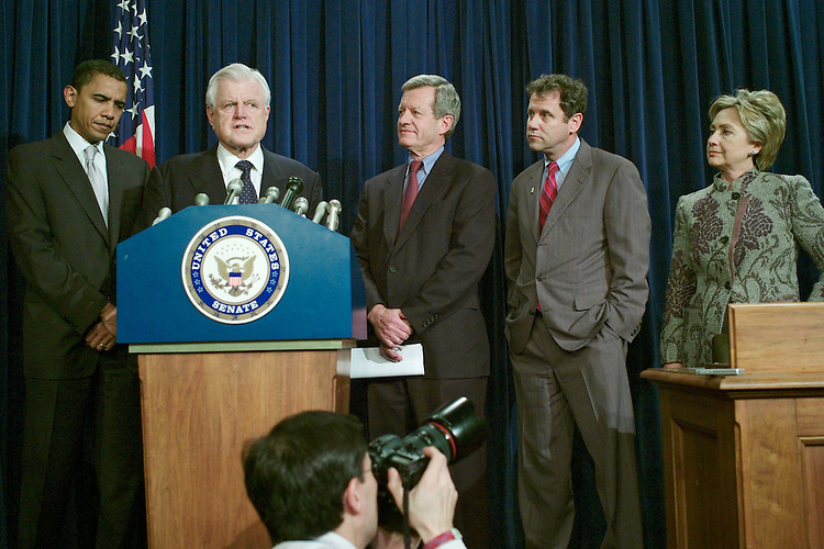 02/01/07--Sen. Barack Obama, D-Ill., Sen. Edward M. Kennedy, D-Mass., Sen. Max Baucus, D-Mont., Sen. Sherrod Brown, D-Ohio, and Sen. Hillary Rodham Clinton, D-N.Y., during a news conference after the Senate capped a two-week debate by passing a bill that combines the first minimum wage increase in a decade with a package of tax breaks for small businesses. (Obama will officially announce a bid for the 2008 Democratic presidential nomination Feb. 10 in an event in his home stateÕs capital of Springfield; Clinton is the the front-runner for the 2008 Democratic presidential nomination.) The legislation would boost the federal minimum by $2.10 an hour, to $7.25, in three steps over two years. It also would extend about $8.3 billion in business tax breaks for varying periods, with the costs offset by a new $1 million cap on how much tax-deferred compensation business executives can receive each year and selected other revenue-raisers. The 94-3 vote on the measure (HR 2) paves the way for potentially difficult negotiations with the House. Speaker Nancy Pelosi, D-Calif., guided a stand-alone wage increase through that chamber, and objected to the SenateÕs decision to attach the business tax breaks to it. Congressional Quarterly Photo by Scott J. Ferrell