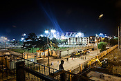Work carries on outside the main stadium for the approaching 19th Commonwealth Games 2010 in New Delhi, India.