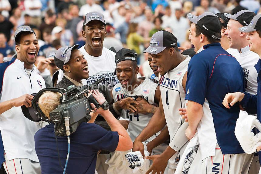 Mar 28, 2009; Glendale, AZ, USA; Connecticut Huskies guard Jerome Dyson (second from left), center Hasheem Thabeet (third from left), guard Craig Austrie (24), forward Jeff Adrien (4), and the rest of their Huskies teammates celebrate in front of a CBS television camera following the Huskies' 82-75 victory over the Missouri Tigers in the finals of the west region of the 2009 NCAA basketball tournament at University of Phoenix Stadium.  With the win, the Huskies advance to the Final Four.