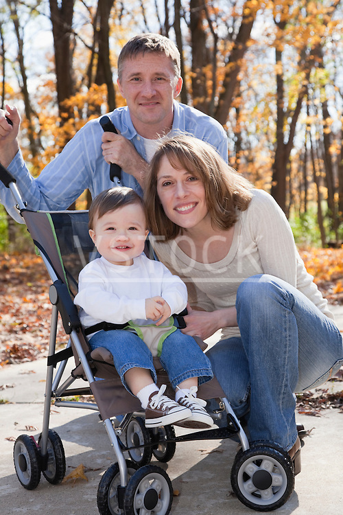 USA, Illinois, Metamora, portrait of parents with baby boy (12-17 months) in stroller