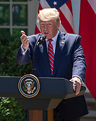 United States President Donald J. Trump answers reporter's questions as he and President Andrzej Duda of the Republic of Poland, conduct a joint press conference in the Rose Garden of the White House in Washington, DC on Wednesday, June 12, 2019. <br /> Credit: Ron Sachs / CNP