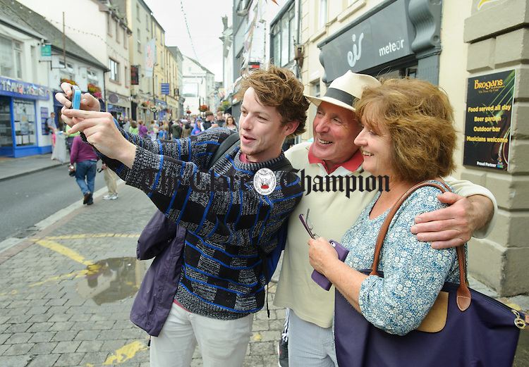Local man Gareth Gregan takes a selfie with Maurice and Treasa O Flaherty of Kildare on O Connell street, Ennis during Fleadh Cheoil na hEireann. Photograph by John Kelly.