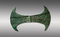 Minoan  cult bronze double axe 'labrys',  1600-1400 BC, Heraklion Archaeological  Museum, grey background.<br /> <br /> In Minoan Crete, the double axe was an important sacred symbol of the supposed Minoan religion. In Crete it never accompanies male gods, only female goddesses. It seems that it was the symbol of the arche of the creation (Mater-arche).