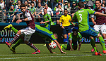 Seattle Sounders' Clint Dempsey is tripped up while being guarded by  Colorado Rapids' Drew Moor during an MLS match on April 26, 2014 in Seattle, Washington. Dempsey scored two goals in the Seattle Sounders 4-1 win over the Colorado Rapids.  Jim Bryant Photo. ©2014. All Rights Reserved.