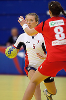 31 MAR 2010 - LONDON, GBR - Britains Nina Heglund (#5) prepares to pass during the Great Britain v Iceland 2010 European Womens Handball Championships qualifier (PHOTO (C) NIGEL FARROW)