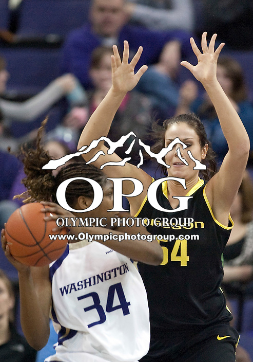 7 March 2010:  Washington Huskies forward #34 Mollie Williams looks for an opening to the basket against Oregon forward #54 Nicole Canepa. Washington won 62-53 over Oregon at the Bank of America Arena in Seattle, WA.