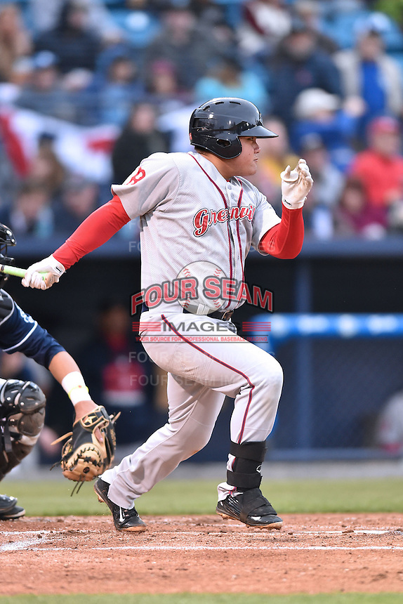 Greenville Drive first baseman Francisco Tellez (19) swings at a pitch during a game against the Asheville Tourists on April 16, 2015 in Asheville, North Carolina. The Tourists defeated the Drive 5-4. (Tony Farlow/Four Seam Images)