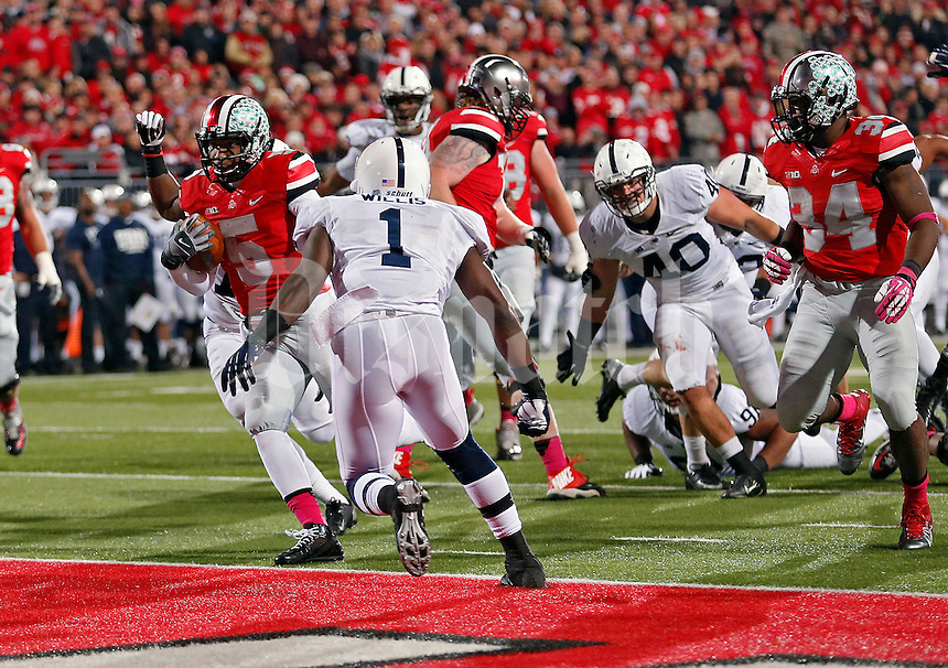 Ohio State Buckeyes quarterback Braxton Miller (5) scores a touchdown on a run against Penn State Nittany Lions in the 2nd quarter at Ohio Stadium on October 26, 2013.  (Dispatch photo by Kyle Robertson)