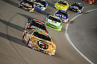 Nov. 21, 2009; Homestead, FL, USA; NASCAR Nationwide Series driver Joey Logano leads the field during the Ford 300 at Homestead Miami Speedway. Mandatory Credit: Mark J. Rebilas-