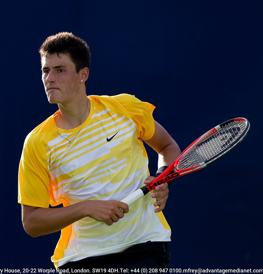 Bernard Tomic (AUS) against Andreas Seppi (ITA) in the first round of the men's singles. Bernard Tomic beat Andreas Seppi 6-3 5-7 6-3..Tennis - ATP World Tour - AEGON Championships - Queen's Club - London - Day 2 - Tues 08 Jun 2010..© AMN Images - Level 1, Barry House, 20-22 Worple Road, London, SW19 4DH.Tel - +44 (0) 208 947 0100.email - mfrey@advantagemedianet.com. www.photoshelter.com/c/amnimages.