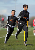 Pictured: Kyle Naughton (R) is chased by Neil Taylor Thursday 25 February<br /> Re: Swansea City FC training at Fairwood, near Swansea, Wales, UK, ahead of their game against Tottenham Hotspur.