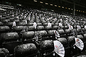 17th March 2018, Craven Cottage, London, England; EFL Championship football, Fulham versus Queens Park Rangers; Heavy snow covers the seats and match day clappers inside Craven Cottage before kick off