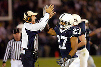 08 October 2005:  Penn State defensive coordinator Tom Bradley congratulates Chris Harrell (27) after the defense took the ball away from Ohio State to seal the win.  The Penn State Nittany Lions knocked off the #6 Ohio State Buckeyes 17-10 October 8, 2005 at Beaver Stadium in State College, PA..